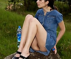 Spying on beautiful  teen peeing in the field