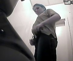 Voyeur videos from ladies' room in warehouse toilet